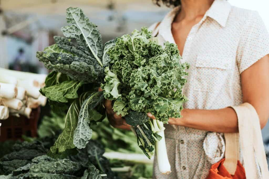 Lady with kale in her hands
